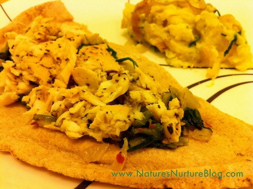 tilapia and dandelion greens on pita