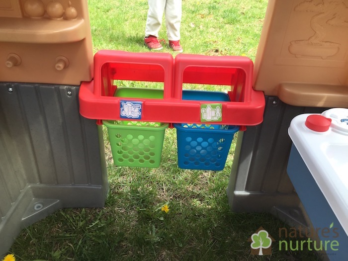 The Little Tikes Go Green Playhouse teaches your little ones all about going green in a fun way! Learn to recycle, use a solar light, care for a garden, and collect rain water all while having fun!